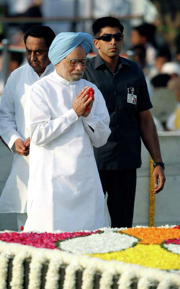Indian Prime Minister Manmohan Singh pays floral tributes to the memorial of Mahatma Gandhi on his birth anniversary in New Delhi , India, Tuesday, Oct. 2, 2012. (AP Photo/ Mustafa Quraishi) Photo: Mustafa Quraishi, Associated Press / AP