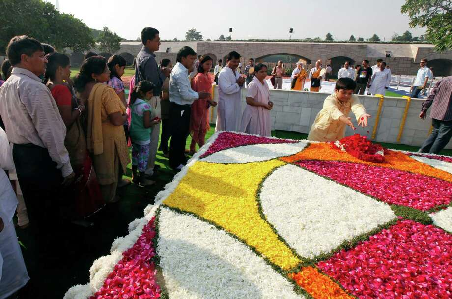 Indians pay floral tributes at the memorial of Mahatma Gandhi on his birth anniversary in New Delhi , India, Tuesday, Oct. 2, 2012. (AP Photo/ Mustafa Quraishi) Photo: Mustafa Quraishi, Associated Press / AP