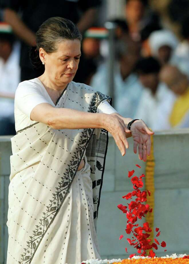 Congress party President Sonia Gandhi pays floral tributes to the memorial of Mahatma Gandhi on the anniversary of his birth in New Delhi , India, Tuesday, Oct. 2, 2012. (AP Photo/ Mustafa Quraishi) Photo: Mustafa Quraishi, Associated Press / AP