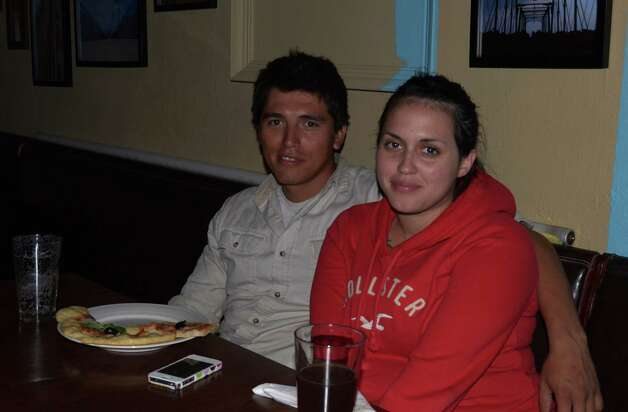Lorenzo and Glelen Valdillez enjoy a classic combo of pizza and beer at Boneshakers on October 1, 2012. Photo: Robin Johnson