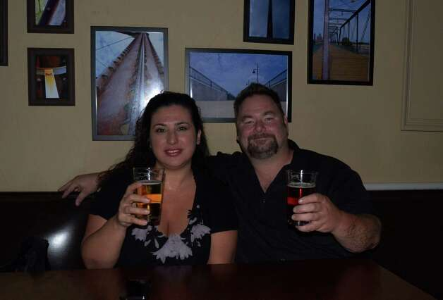 Christopher Bryan and Tricia Brackett drink and admire the local art displayed on the walls of Boneshakers on October 1, 2012. Photo: Robin Johnson