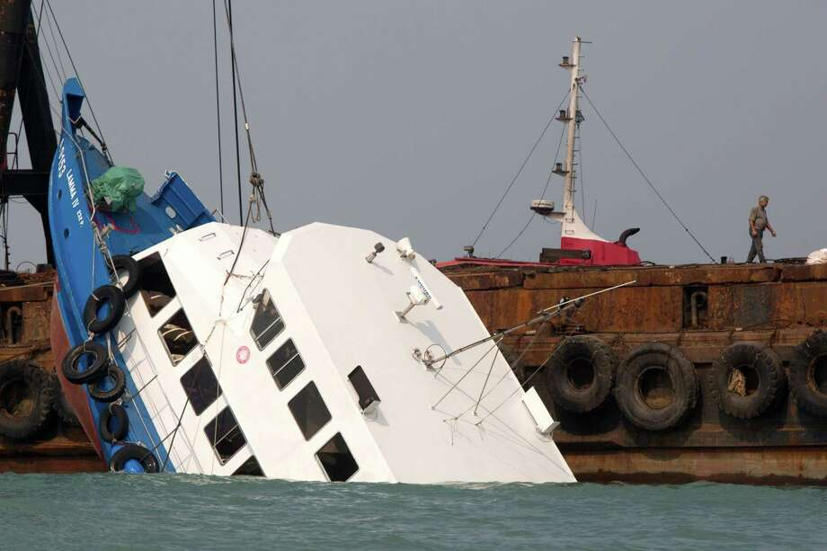 HONG KONG - OCTOBER 2:  The stricken ferry is pulled out of the water near Yung Shue Wan on Lamma Island on October 2, 2012 in Hong Kong.  Thirty-six passengers have been killed and several others were injured when a Hong Kong Electric ferry, carrying 124 people, collided with a tug boat off the coast of Hong Kong late on Monday. Photo: Getty Images / 2012 Getty Images