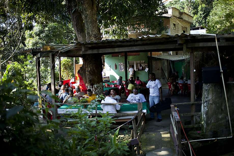 Residents of Rio de Janeiro's Quilombo Sacopa celebrate their culture by sharing feijoada, a stew. Photo: Victor R. Caivano, Associated Press