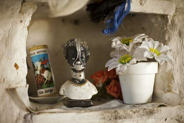 An image of Anastacia, a slave figure venerated as a saint, decorates a public space in Quilombo Sacopa. Photo: Victor R. Caivano, Associated Press