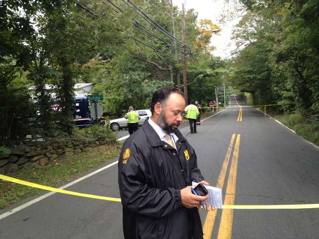 Greenwich Police Lt. Kraig Gray stands near the scene of a fire the morning of Tuesday, Oct. 2, 2012 that left a man dead and a woman seriously injured in Old Greenwich, Conn. Photo: Staff Photo