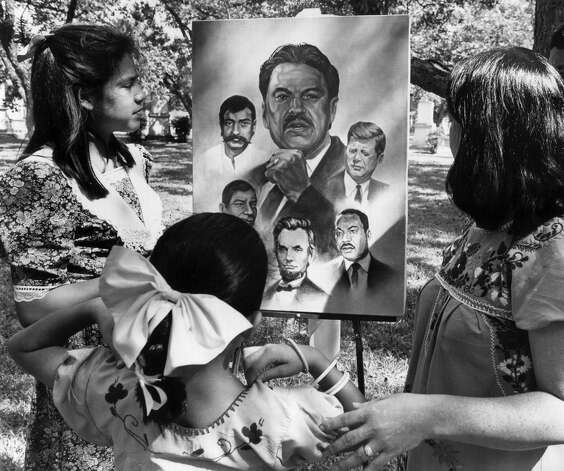 Catarina Velásquez, 12, the daughter of the late Willie Velásquez, admires a portrait of her father that was painted in 1988. Catarina says she learned the importance of giving back and supporting the community from him. Photo: MARIANNE THOMAS, EXPRESS-NEWS FILE PHOTO / SAN ANTONIO LIGHT