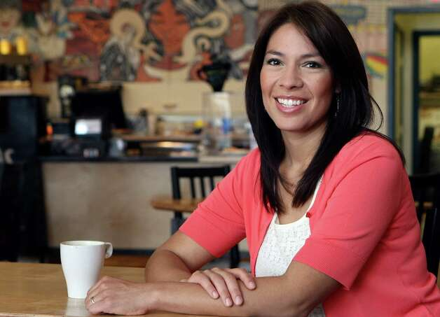 Catarina Velasquez, manager of Guadalupe Street Coffee House, at her business.  Her father Willie Velasques was the founder of the Southwest Voter Registration and Educational Project in the 70s and influenced her work in running the nonprofit coffee shop that works closely with West Side youth, to keep students engaged and away from gangs. Photo: Helen L. Montoya, San Antonio Express-News / ©SAN ANTONIO EXPRESS-NEWS
