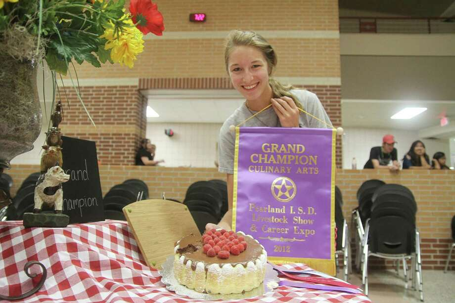 Katelyn Kenney was awarded Grand Champion of Culinary Arts for her Momma's Mousse Cake at the first Pearland Livestock Show and Career Expo. More photos on Page 5. Photo: Pin Lim / Copyright Pin Lim.