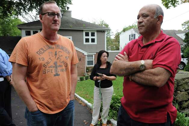 Neighbors Robert Meen, left, Gladys Pardo and her husband John speak about a fire next door to their homes on Havemeyer Lane in Old Greenwich that killed a 42-year-old man and seriously injured a woman Tuesday morning, Oct. 2, 2012. Photo: Helen Neafsey / Greenwich Time