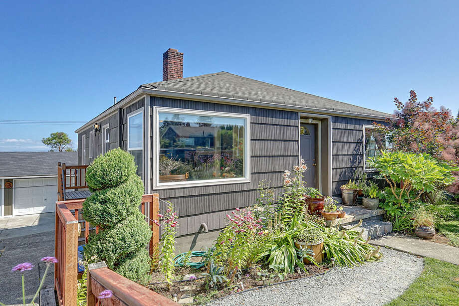 Delridge runs along the east side of West Seattle, featuring homes that generally are more affordable than those to the west, and views of the city and Mount Rainier. Here are three houses listed there for around $350,000, starting with 7334 30th Ave. S.W. The 1,540-square-foot house, built in 1942, has three bedrooms and 1.75 bathrooms -- including a master bedroom with a big walk-in closet -- a den, a wine cellar, a view deck, a garden and a greenhouse on a 5,850-square-foot lot. It's listed for $360,000. Photo: Courtesy Richard Bianchi/Keller Williams Realty