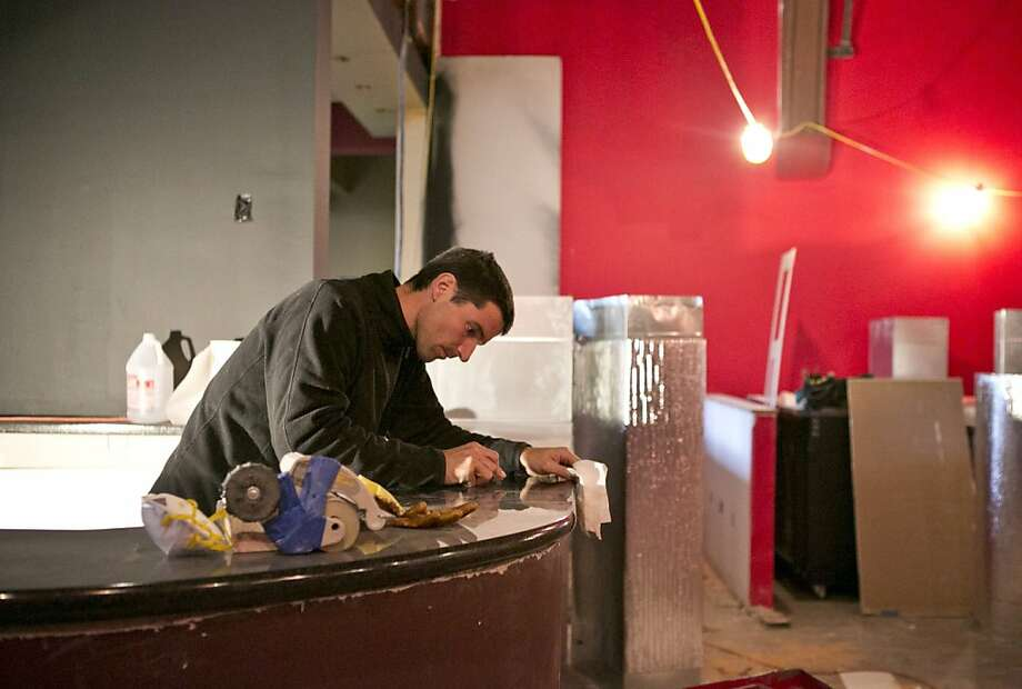 Last week, Julien Carmellino was putting the finishing touches on the granite bar at Preservation Hall West at the Chapel on Valencia Street, a new restaurant and club. Photo: Laura Morton, Special To The Chronicle