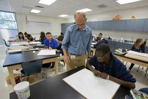 10/1/12: Grady Middle School Art teacher Loren Gardner teaches his classroom and Elijah Chambers, age 14, about perspective in the new art classroom located inside the new addition oat Grady Middle School in Houston, Texas. The addition was built under the district's 2007 capital program. The school would be completed under the 2012 bond proposal.