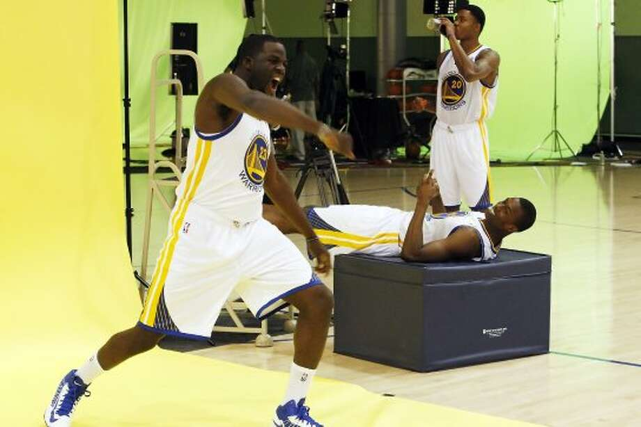 Harrison Barnes, reclining, laughs as teammate, Draymond Green strikes a pose as the Golden State Warriors met with the press during their annual Media Day. (Carlos Avila Gonzalez / The Chronicle)
