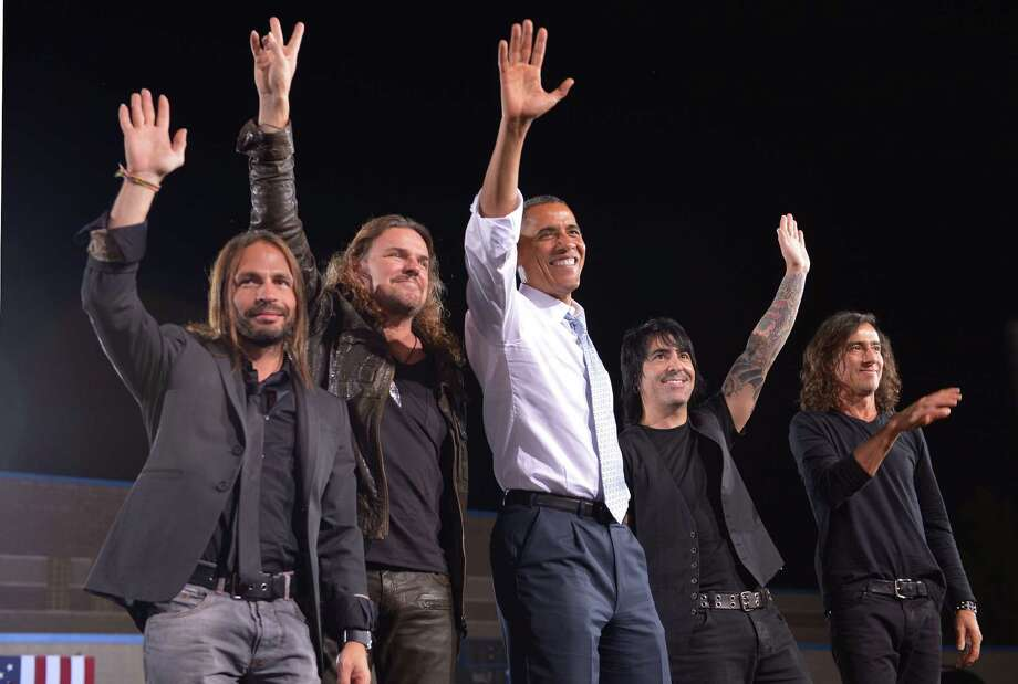 "President Barack Obama waves with Latin pop band ""Mana"" during a campaign event. Photo: MANDEL NGAN, AFP/Getty Images / AFP"