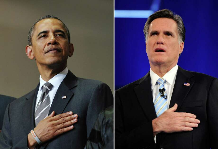 This combination of file pictures shows US President Barack Obama (L) listening to the national anthem during the Joplin High School Commencement Ceremony May 21, 2012 at Missouri Southern State University in Joplin, Missouri, and US Republican presidential candidate Mitt Romney (R) singing the national anthem at a debate sponsored by CNN and the Republican Party of Arizona at the Mesa Arts Center February 22, 2012 in Mesa, Arizona. AFP PHOTO Mandel NGAN/AFP - Ethan Miller/Getty Images/AFP-/AFP/GettyImages Photo: -, AFP/Getty Images / AFP