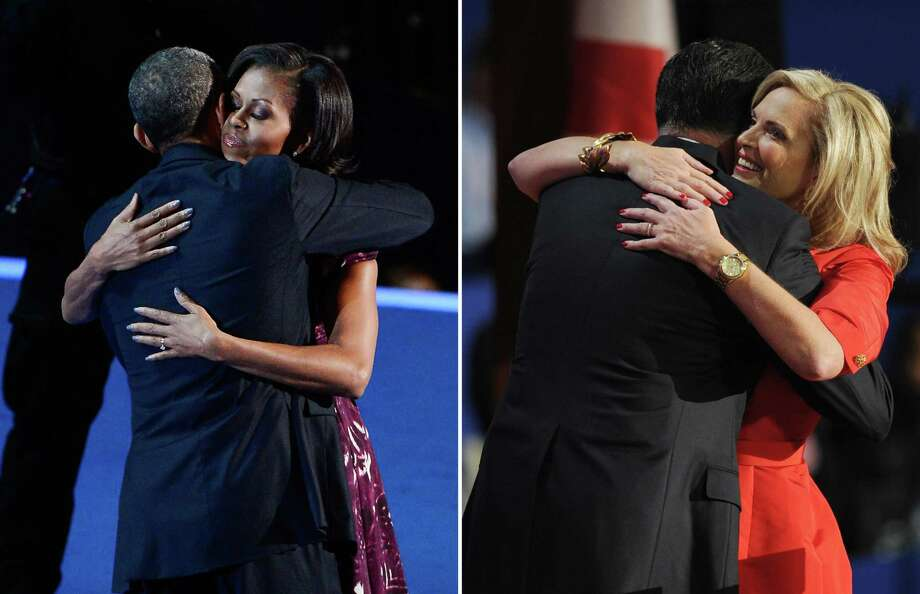 This combination of file pictures shows (L) US President Barack Obama huging First lady Michelle Obama during the final day of the Democratic National Convention at Time Warner Cable Arena on September 6, 2012 in Charlotte, North Carolina, and (R) US Republican presidential candidate Mitt Romney and wife Ann embracing at the Tampa Bay Times Forum in Tampa, Florida, on August 28, 2012 during the Republican National Convention. AFP PHOTO/ Kevork Djansezian/Getty Images/AFP - Robyn BECK/AFP-/AFP/GettyImages Photo: -, AFP/Getty Images / AFP