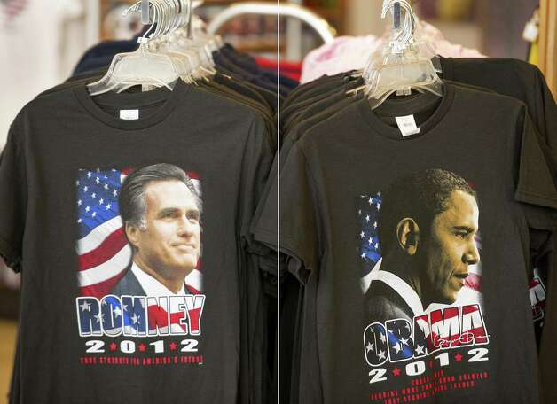 This combination of file pictures shows T-shirts bearing the image of Republican presidential candidate Mitt Romney (L) and the image of US President Barack Obama (R) for sale at a retail shop inside Dulles International Airport near Washington, DC, September 17, 2012 in Chantilly, Virginia. AFP Photo/Paul J. Richards-/AFP/GettyImages Photo: -, AFP/Getty Images / AFP