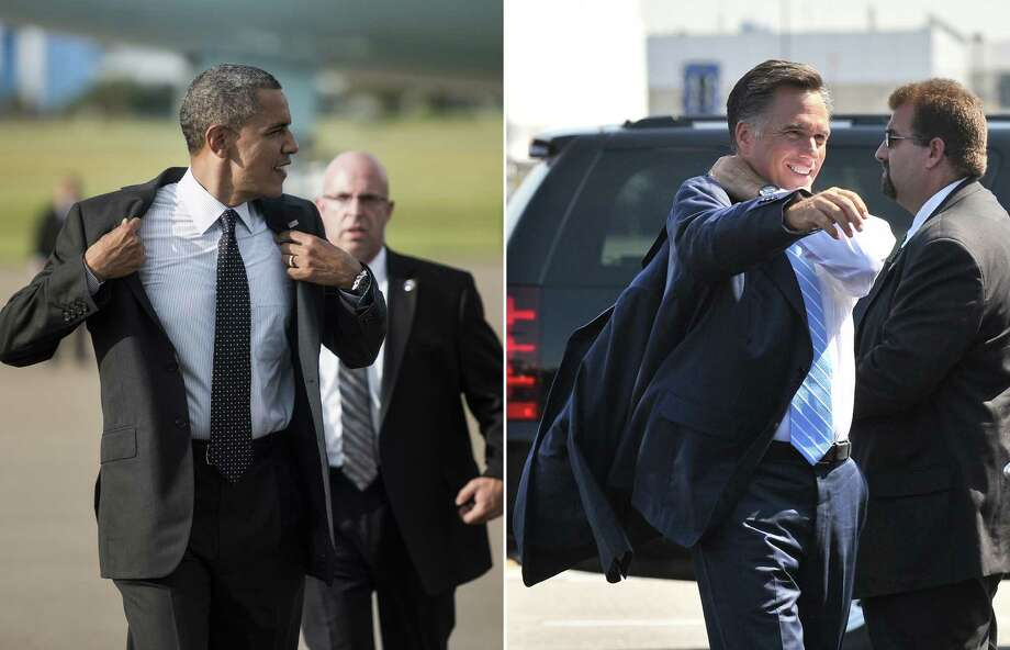 This combination of file pictures shows US President Barack Obama (L) removing his jacket after arriving at Tampa International Airport on September 20, 2012 in Tampa, Florida, and US Republican presidential candidate Mitt Romney (R) puting on his jacket before departing Newark airport in New Jersey for Ohio where he will address a campaign rally on September 14, 2012. AFP PHOTO/ Brendan SMIALOWSKI /Nicholas KAMM-/AFP/GettyImages Photo: -, AFP/Getty Images / AFP