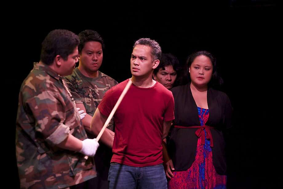 "Tasi Alabastro (Captain Rivera, left), Patrick Silvestre (Corporal), Ryan Morales (Bayani), Jed Presario (Private) and Christine Jugeta (Nena) in ""The Strange Case of Citizen de la Cruz."" Photo: Paciano Tiunfo"