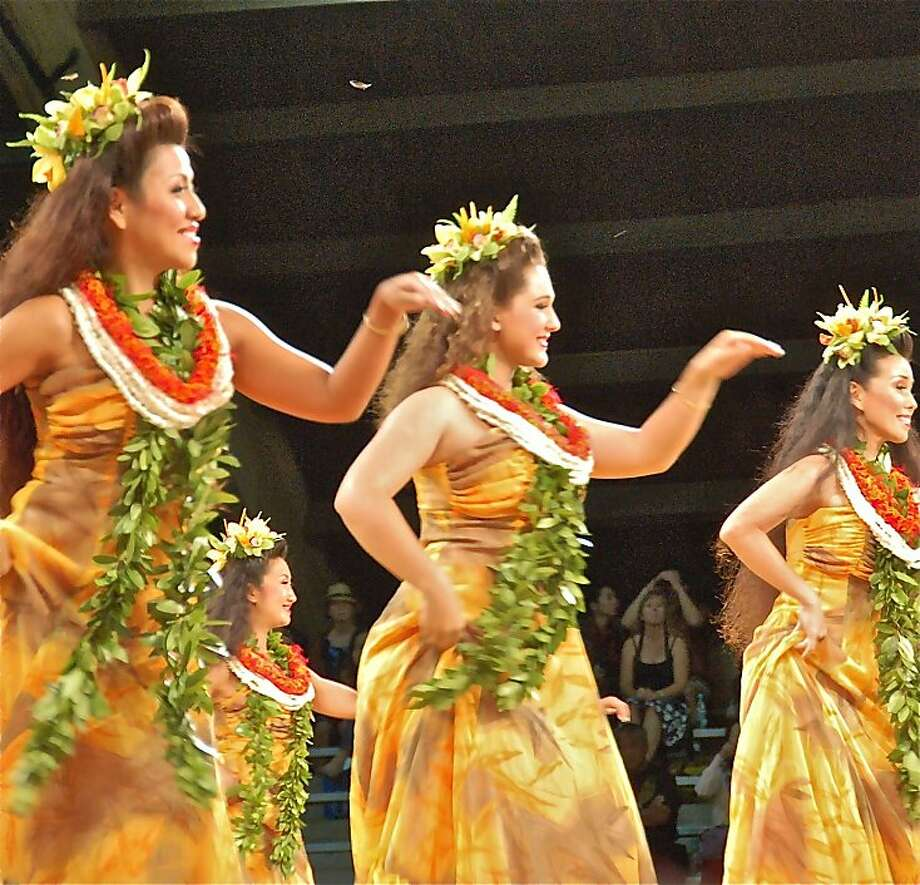 The 2011 Merrie Monarch Festival in Hilo, Hawaii, features hula dancers from Keolalaulani Halau Olapa O Laka, which offers classes in Hawaii, Japan and San Mateo. Photo: Jeanne Cooper