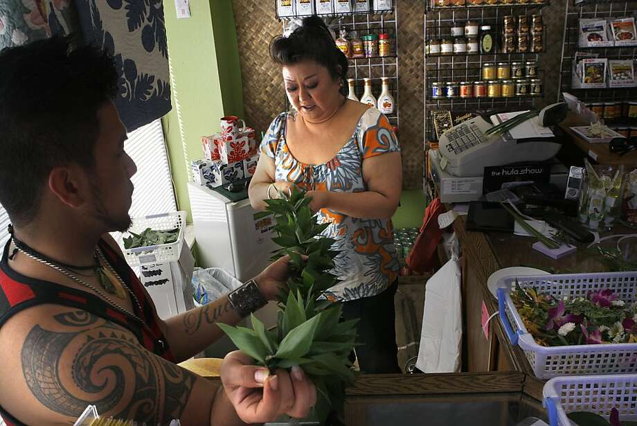 Rudy Keawe (left) helps Leah Dang make the Mayor Ed Lee-favored Maile-style ti braid lei at the Aloha Warehouse in San Francisco. Dang's shop began making leis in 2008. Photo: Liz Hafalia, The Chronicle