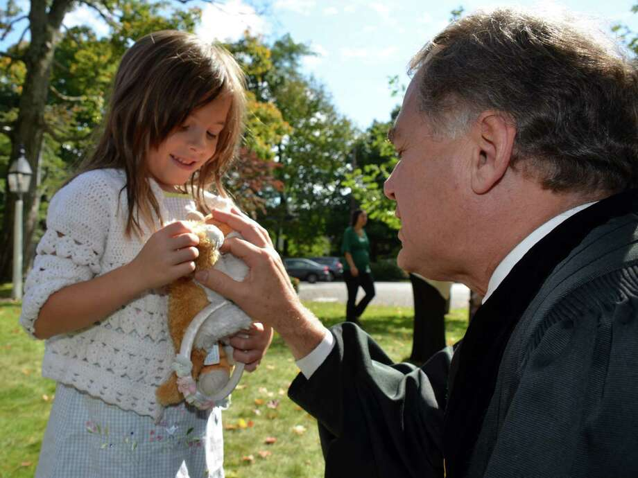 The Reverend Dale Rosenberger of the First Congregational Church, blesses Thea Kline's cats - Jack Sparrow and Jack Bauer!  Though the kitties could not make it in person, Thea had substitutes.  September 30, 2012, Darien, Conn. Photo: Jeanna Petersen Shepard