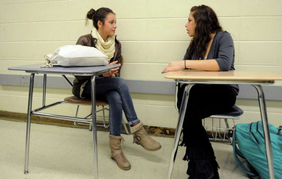 Elisa Cassinelli talks to American student Jessica Casinelli, no relation, about her life in Italy during an Italian 2 class at Westhill on October 2, 2012. Photo: Lindsay Niegelberg / Stamford Advocate