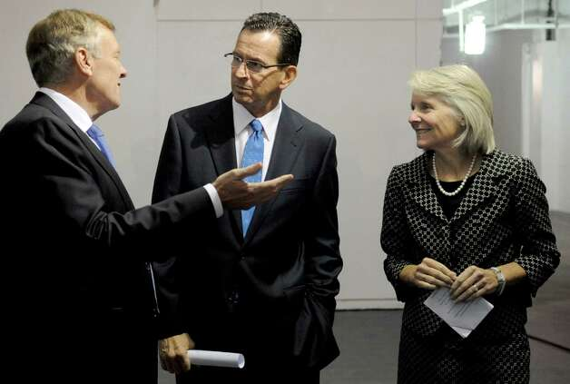 From left, Charter CEO Tom Rutledge, Governor Dannel Malloy, and Catherine Smith, Commissioner of the Department of Economic and Community Development, speak before a press conference on Tuesday, October 2, 2012, at 400 Atlantic Street in Stamford to announce Charter Communication will be coming to the town. Photo: Lindsay Niegelberg / Stamford Advocate