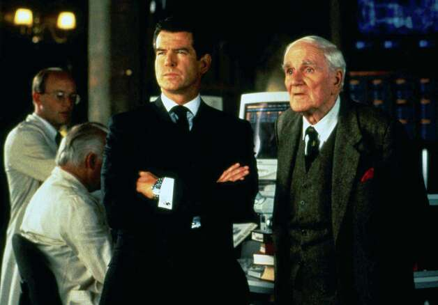 "1999: The World is Not Enough — Desmond Llewelyn stars as Q, right, and Pierce Brosnan stars as James Bond in a scene from ""The World is Not Enough."" Photo: Anonymous, Associated Press / AP2009"