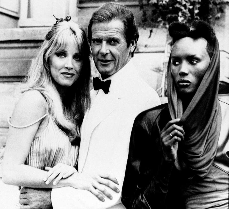 "A View to a Kill, 1985Grace Jones, right, steals the show in ""A View to a Kill"" with Roger Moore and Tanya Roberts. This was Moore's last film as Bond. Photo: ALEXIS DUCLOS, Associated Press / AP1984"