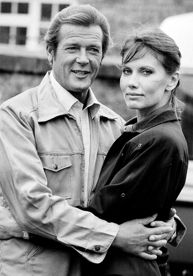 """Octopussy, 1983Roger Moore, poses with his leading lady, Swedish actress Maud Adams, on the set of the production """"Octopussy,"""" on September 6, 1982. Photo: Associated Press / AP1982"""