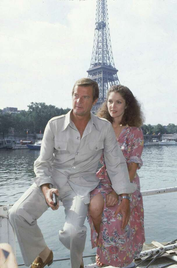 "Moonraker, 1979Co-stars Roger Moore, left, and Lois Chiles pose by the Eiffel Tower in Paris, France, Aug. 7, 1978, one week before filming begins for the 11th James Bond film, ""Moonraker.""  Chiles will play the part of Dr. Holly Goodhead. Photo: Associated Press / AP1978"
