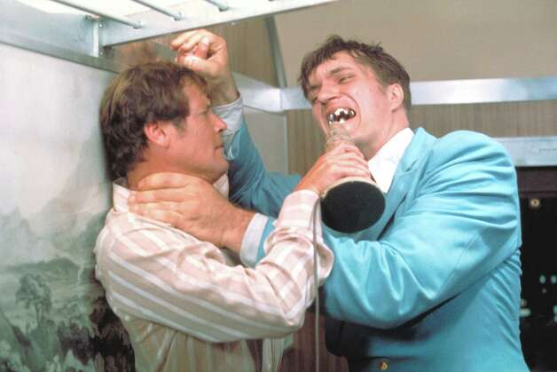 "1977: The Spy Who Loved Me —  Richard Kiel, right, as Jaws and Roger Moore, as James Bond, fighting in the 1977 film, ""The Spy Who Loved Me."" Those teeth could do some serious damage. Photo: Associated Press"