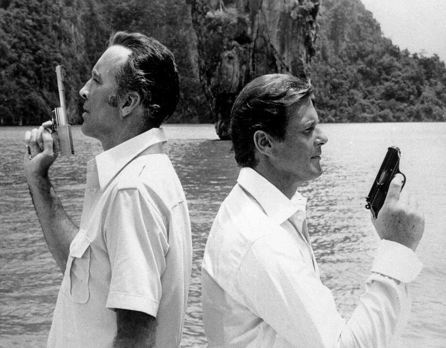 "The Man With the Golden Gun, 1974British actor Christopher Lee, left, who plays villain Francisco Scaramanga, and British actor Roger Moore, as James Bond, film a scene of Ian Flemming's ""The Man with the Golden Gun."" Photo: Anonymous, Associated Press / AP1974"