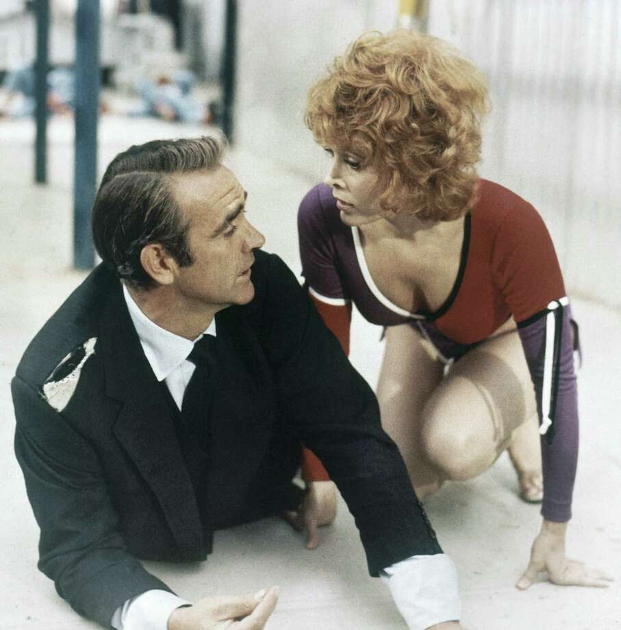 "1971: Diamonds are Forever — Sean Connery resumes the role and gets a helping hand from American actress Jill St. John in a scene from the new James Bond film ""Diamonds Are Forever."" Photo: Associated Press"