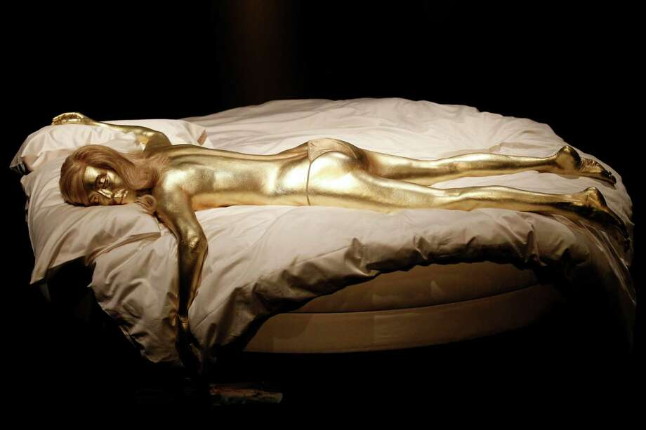 Goldfinger, 1964A recreation of Jill Masterson's golden body in the film 'Goldfinger' is seen on display in the exhibition 'Designing 007 - Fifty Years of Bond Style' at the Barbican centre in London in 2012. Photo: Associated Press