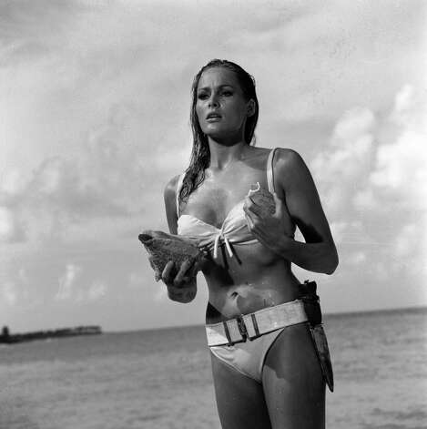 "1962: Dr. No — Ursula Andress in a scene from the James Bond film, ""Dr. No."" Her image personifies the gorgeous, mysterious cool of the Bond girl. Photo: Associated Press / United Artists and Danjaq, LLC"