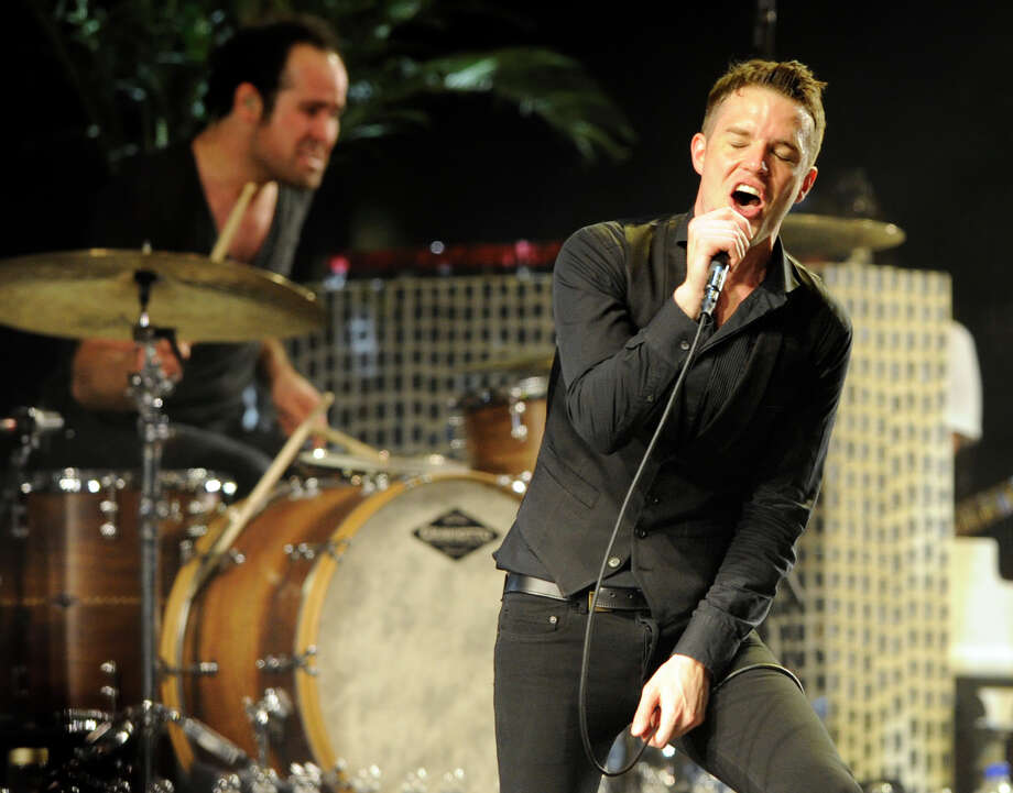 Brandon Flowers wanted to get his voice right before hitting the studio to record the band's latest album, so he took voice lessons. Photo: Associated Press File Photo / AP