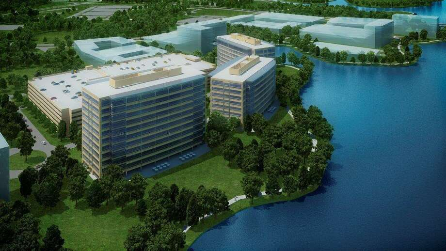 An artist's rendering shows the planned Hughes Landing Office complex along Lake Woodlands. The development will be a 66-acre commercial real estate project. Photo: Courtesy Of The Woodlands Develo
