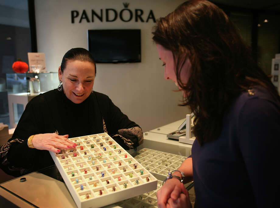 Owner Judy Kiselstein, left, shows Murano glass Pandora beads to Meghan Swan, of Fairfield, at J. Albert Johnson Jewelers at 1957 Black Rock Turnpike in Fairfield on Tuesday, October 2, 2012. Photo: Brian A. Pounds / Connecticut Post