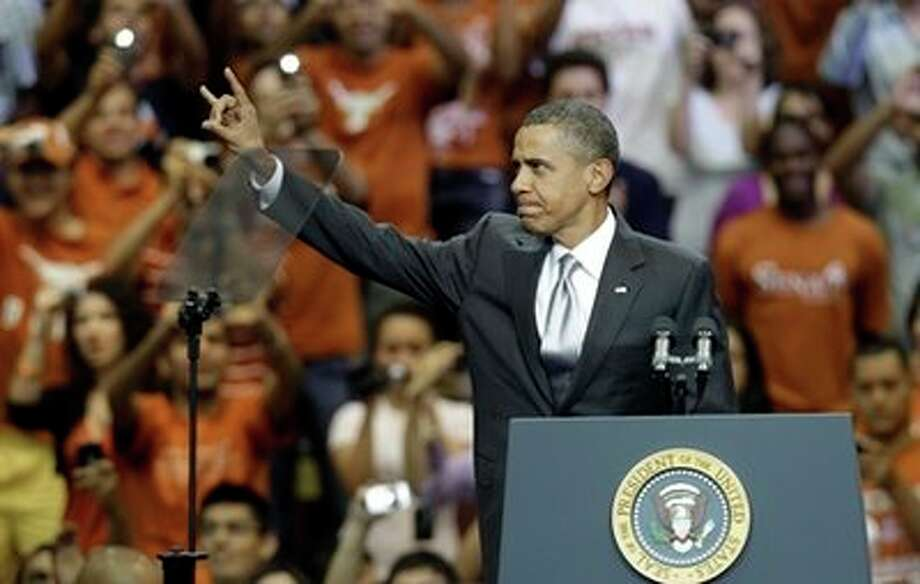 "President Barack Obama gives a ""hook 'em horns"" sign before a speech at Gregory Gym at the University of Texas in Austin, Texas, Monday, Aug. 9, 2010.  (AP Photo/LM Otero) (AP)"