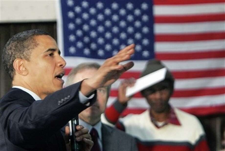 Democratic presidential hopeful Sen. Barack Obama, D-Ill., speaks with veterans during a campaign event at the American Legion Post 490 Friday, Feb. 29, 2008, in Houston, Texas. (AP Photo/Rick Bowmer) (AP)