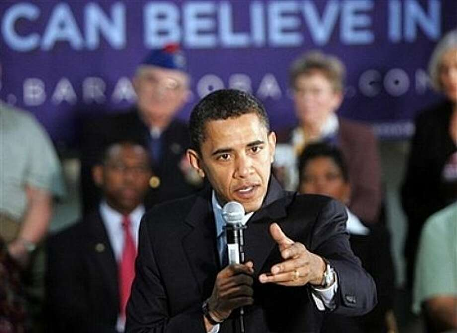 Democratic presidential hopeful Sen. Barack Obama, D-Ill., talks with veterans gathered for a town hall-style campaign  event at the American Legion Post 490 Friday, Feb. 29, 2008, in Houston, Texas. (AP Photo/Rick Bowmer) (AP)