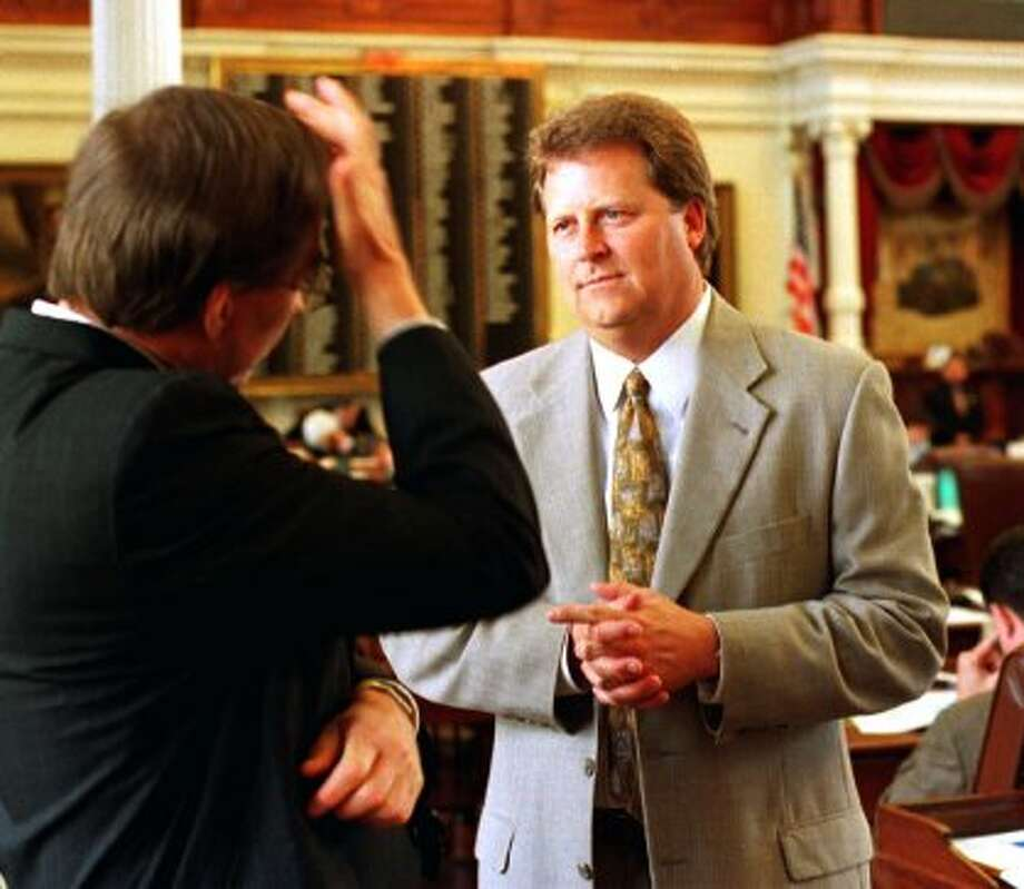 Rep. Paul Sadler, D-Henderson, right, chairman of the House Public Education Committee, talks with another member in the Texas House of Representatives on Thursday, May 20, 1999, in Austin, Texas. Sadler's panel approved a $3.8 billion proposal on Thursday that aims to give every Texas public school teacher a $3,000 pay raise. The bill is expected to reach the House floor for debate on Sunday. (HARRY CABLUCK / AP)