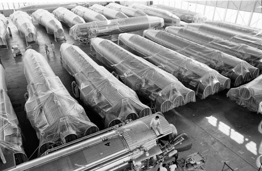 Obsolete Atlas missiles are shown wrapped and stacked side by side at Norton Air base, 