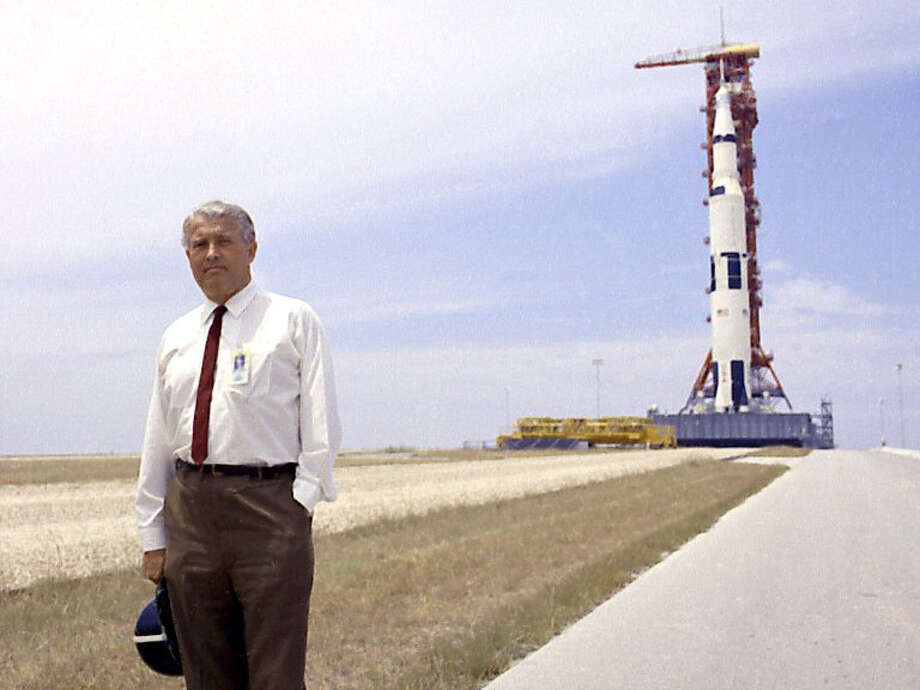 Wernher von Braun pauses in front of the Saturn V vehicle being readied for the historic Apollo 11 lunar landing mission at the Kennedy Space Center on July 1, 1969. Photo: NASA Marshall Space Flight Center
