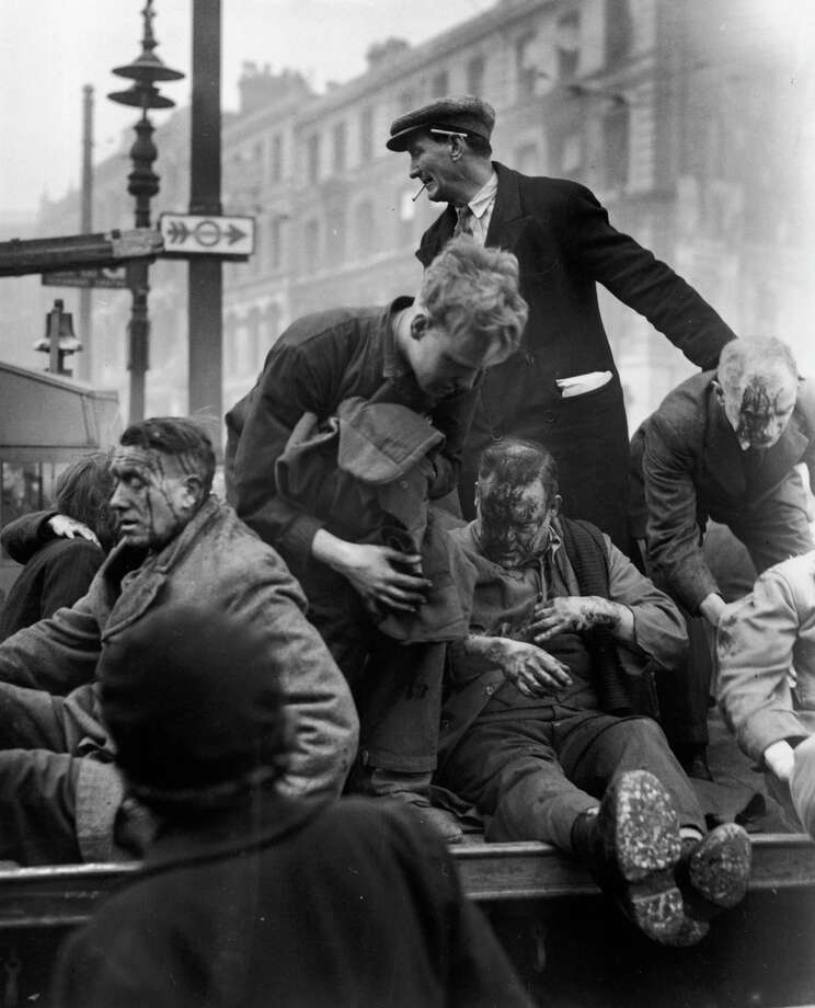 Injured civilians are assisted by rescue workers after a German V-2 rocket exploded in Farringdon Road, London, in 1945. Photo: Keystone, Getty Images / 2008 Getty Images