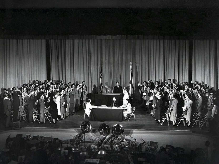 In a ceremony at Huntsville (Ala.) High School, 103 German-born scientists and engineers, along with family members, take the oath to become United States citizens on April 14, 1955. Wernher von Braun is third from the right side in the second row. Photo: NASA Marshall Space Flight Center