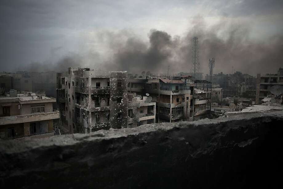 A neighborhood in Aleppo stands battered after weeks of fighting between Syrian rebels and the forces of President Bashar Assad. Activists estimate 30,000 people have been killed nationwide in the conflict. Photo: Manu Brabo, Associated Press