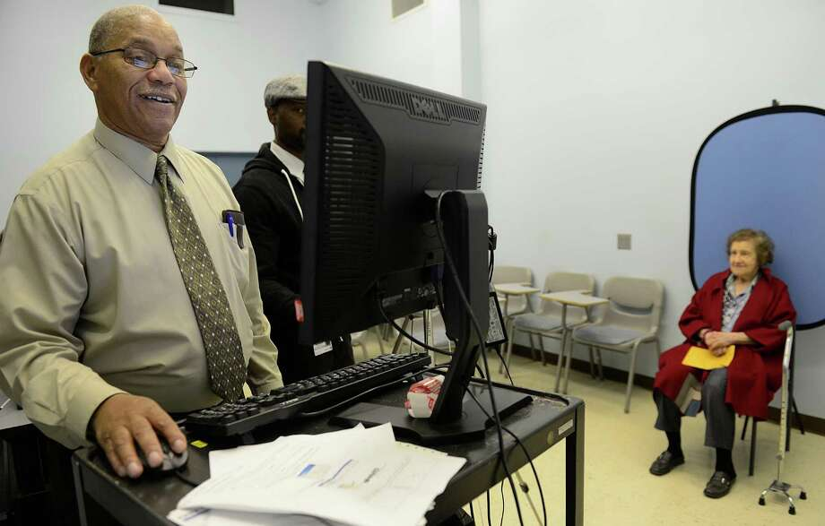 A Pennsylvania judge ruled election precinct workers will still be allowed to ask voters for a valid photo ID, but people without it can still vote. Photo: Julia Rendleman, Associated Press / Pittsburgh Post-Gazette